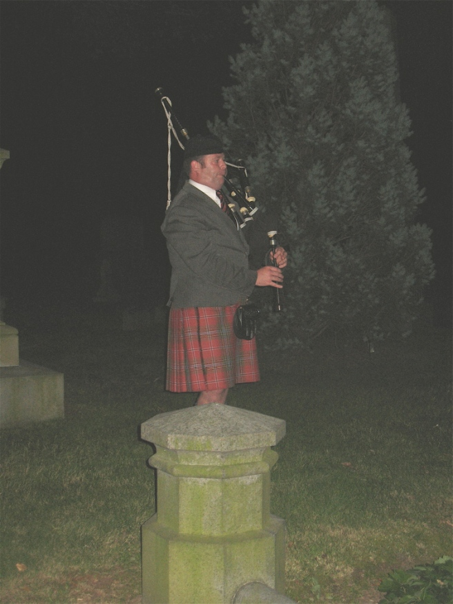 "This bagpiper appeared out of a dark corner of the cemetary playing ""Amazing Grace"""