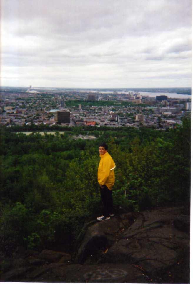 Taking in the view of Montreal in my bright yellow bicycling jacket.