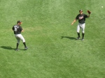 A pair of Tides toss the ball in the outfield.