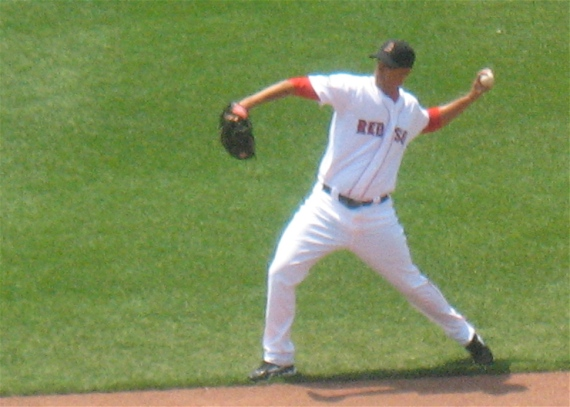 Pitcher Félix Doubront warms up in the outfield.