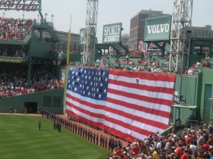 Celebrating America with the National Anthem and a big flag.