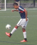 Juan Agudelo warms up before the game.