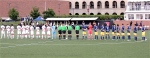 Teams line up for the National Anthem.