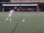 Gabe Latigue takes a free kick for the Revs.