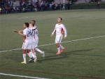 The Revs celebrate another goal.