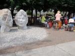 Sculptures and drummers.