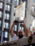 Shane Victorino hoists the trophy.
