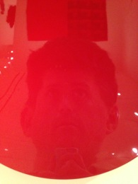 """Me, reflected in """"Untitled (Shu-red),"""" 2007 by Anish Kapoor"""