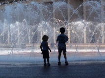 Playing by the fountain.