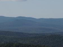 Wind turbines on a distant ridge