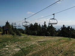Chair lifts hang silent & empty.