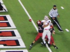 Harvard defense prevents Brown from scoring.