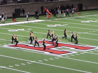 The Harvard dance squad does a quick show between quarters.