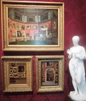 Meta: Paintings of paintings hung salon style that are hung salon style.