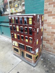 A bit of placemaking, a signal box painted to resemble an apartment building.