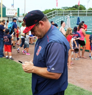 Coach Rich Gedman signs a ball