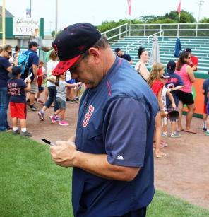 Coach Rich Gedman signs a ball