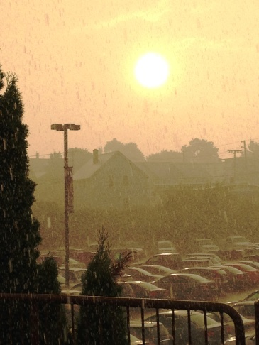 The sun peeks through the rain