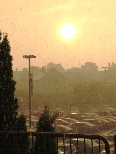The sun peeks through the rain