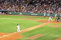 Dustin Pedroia dances off third with Papi at the plate