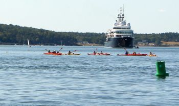 Sea kayaks and giant yacht in Frenchman Bay