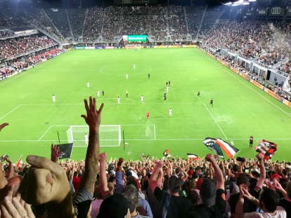 D.C. United supporters celebrate a Wayne Rooney goal.