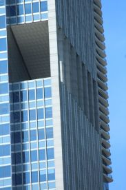 Jeanne Gang's Aqua Tower peaks out around another building.